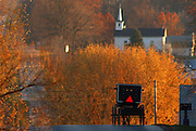 An Amish buggy makes its way home along Ingelhart Road in Manchester, Wi., Saturday. St. Paul's Evangelical Church is in the background as the sun sets on the afternoon. JEFFREY PHELPS PHOTO