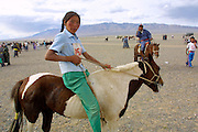 GOBI DESERT, MONGOLIA..08/26/2001.Bayangovi. Local Naadam festival. Runners-up of a horse race over 30 kilometers..(Photo by Heimo Aga).