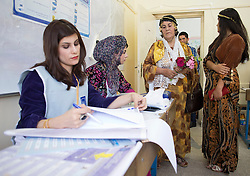 © Licensed to London News Pictures. 30/04/2014. Sulaimaniya, Iraq. Dressed in traditional clothing, an Iraqi-Kurdish woman queues to vote inside a school being used as a pooling station in Sulaimaniya, Iraqi-Kurdistan today (30/04/2014). <br /> <br /> The period leading up to the elections, the fourth held since the 2003 coalition forces invasion, has already seen polling stations in central Iraq hit by suicide bombers causing at least 27 deaths. Photo credit: Matt Cetti-Roberts/LNP
