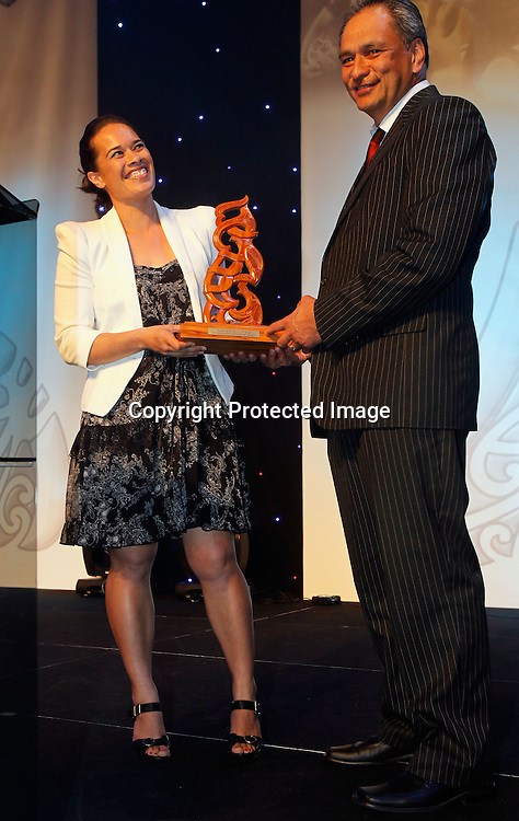 Senior Maori Sportsman presented by the Trillian Trust is awarded to All Black Piri Weepu and is accepted by his cousin Rewa Harriman. Trillian Trust 2011 Maori Sports Awards, Telstra Clear Pacific Events Centre, Saturday 3rd December 2011. Photo: Shane Wenzlick / Photosport.co.nz