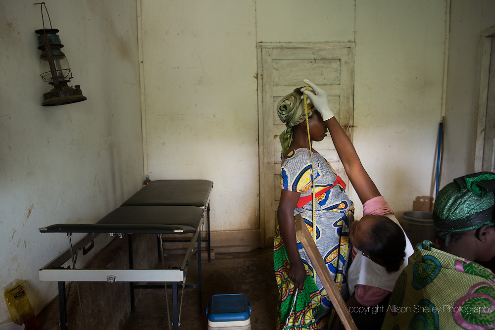 A pregnant woman is given a check-up by staff of Medecins Sans Frontieres during a medical outreach in the village of Lukweti, Masisi in conflict-ridden North Kivu, Democratic Republic of Congo, July 29, 2014.