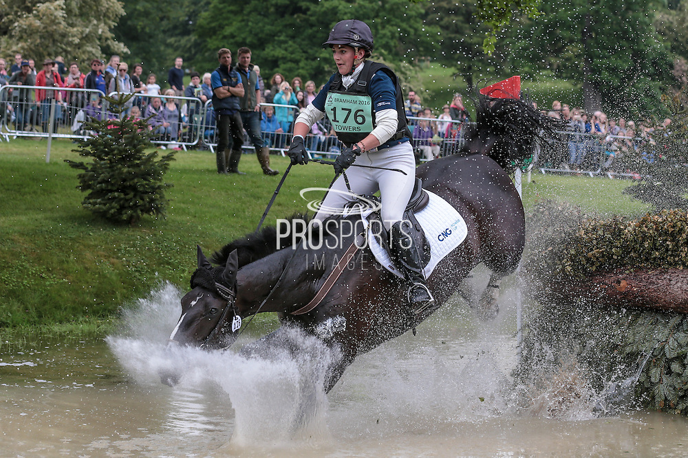 Hazel Towers riding SIMPLY SMART is nearly thrown as the horse lands awkwardly in the water jump at Bramham International Horse Trials 2016 at  at Bramham Park, Bramham, United Kingdom on 11 June 2016. Photo by Mark P Doherty.