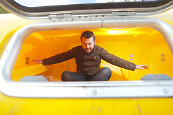 Nick Hancock inside his survival pod. He will head for Rockall in the Atlantic, and the adventurer is planning to spend two months on Britain's most remote outpost, and he is building his survival pod in his back garden..© Michael Schofield..