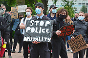 Protesterwith police brutality poster during the Black Lives Matter protest at Queens Gardens, Hull, United Kingdom on 10 June 2020.