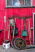 Tools on a red wall at the Palmetto Horse barn in historic Charleston, SC.