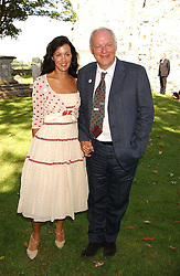 Musician DAVID GILMOUR and his wife POLLY SAMPSON at the wedding of musician Jools Holland to Lady Crystabel Durham held at Cooling Village Church, Cooling, Kent on 30th August 2005.<br /><br />NON EXCLUSIVE - WORLD RIGHTS