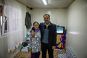 """Mehmet Kershi born 1958 in Djakovica, Kosovo with his wife Bedrie Emini. He is the father of nine daughters and one son.Mr. Kershi fled the war in Kosovo and lives from 1999 in the Konik Camp located in Podgorica. After the fire in 2012 when many inhabitants lost their former housing they received a container in which they live in since then. He has no valid papers such as Passport and Identity Card and is since his arrival in Montenegro unemployed. He partly corporates with the """"Crisis Council of the Association of Displaced Roma and Egyptians from Kosovo in Montenegro"""" and belongs to the Egyptians in the community."""
