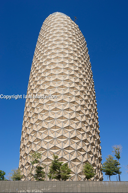 Exterior of Al Bahr (Al Bahar) towers in Abu Dhabi United Arab Emirates; Innovative sun shielding exterior comprising protective skin of automatic umbrellas like elements that open and close depending on intensity of sunshine.
