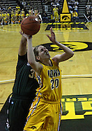 January 27 2010: Iowa forward Kelly Krei (20) puts up a shot as Michigan St. forward Kalisha Keane (32) defends during the second half of an NCAA women's college basketball game at Carver-Hawkeye Arena in Iowa City, Iowa on January 27, 2010. Iowa defeated Michigan State 66-64.