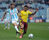 Martin Cranie of Huddersfield Town battles with Andre Gray of Burnley during the Sky Bet Championship match at the John Smiths Stadium, Huddersfield<br /> Picture by Graham Crowther/Focus Images Ltd +44 7763 140036<br /> 12/03/2016