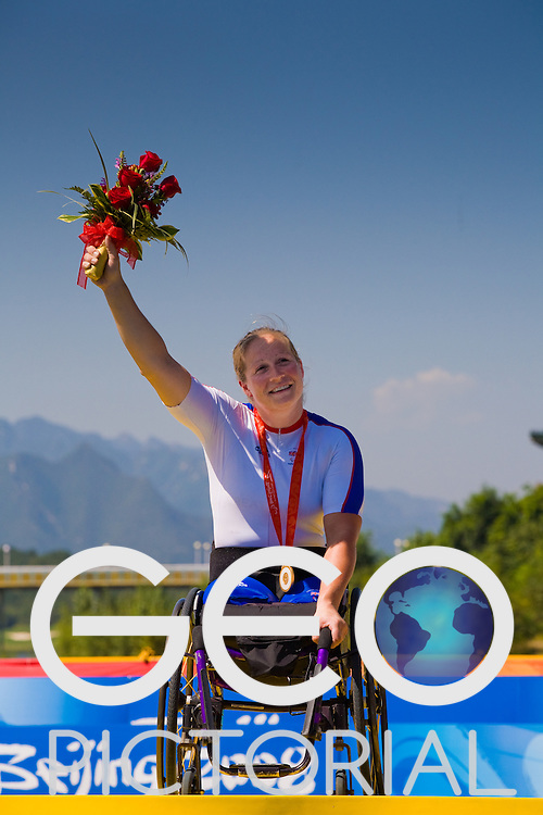 BEIJING, SEPTEMBER 12: Rachel Morris of Great Britain celebrates on the podium with her gold medal for the women's Road Cycling Road Race Handcycling (HC A) at the Triathlon Venue during day six of the 2008 Paralympic Games on September 12, 2008 in Beijing, China.