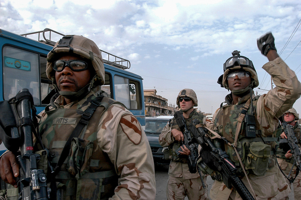 American army soldiers patrol the poor Shia neighborhood of Sadr City. The vast slum is a hotbed of support for radical Shiite cleric Moqtada al-Sadr. His militia, the Mahdi Army, attack Coalition forces on a daily basis.<br /> Baghdad, Iraq. 02/05/2004