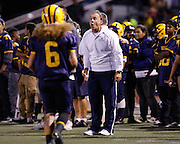 Milpitas High School varsity football host Woodside at Milpitas High School in Milpitas, California, on September 13, 2013. (Stan Olszewski/SOSKIphoto)