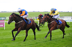 Plough Boy ridden by Killian Leonard (left) before winning the Plusvital Handicap ahead of Texas Rock ridden by O J Orr (right) at Curragh Racecourse, Co. Kildare, Ireland.
