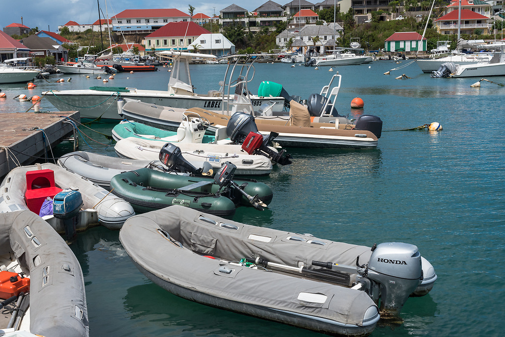 Gustavia, St Barths-- April 25, 2018. Dinghies are tied up and waiting in  Gustavia harbor. Editorial Use Only.