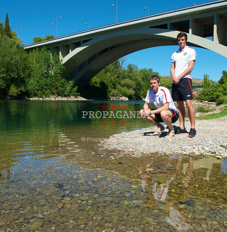 PODGORICA, MONTENEGRO - Thursday, September 2, 2010: Wales' Chris Gunter and Gareth Bale pose for a photograph by the Moraca River that runs through Podgorica ahead of the UEFA Euro 2012 Qualifying Group 4 match against Montenegro. (Pic by David Rawcliffe/Propaganda)