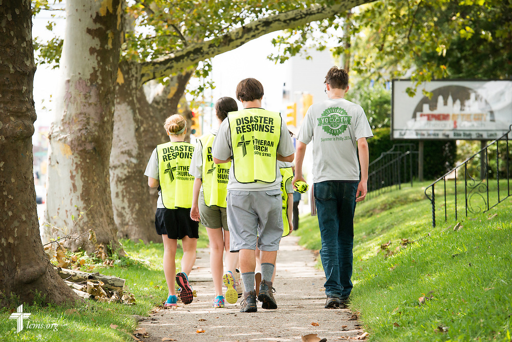 Participants in the 2014 Youth Corps pilot project walk back to the fellowship hall following a portrait shoot for LCMS Disaster Response at Shepherd of the City Lutheran Church on Wednesday, August 13, 2014, in Philadelphia, Pa. LCMS Communications/Erik M. Lunsford