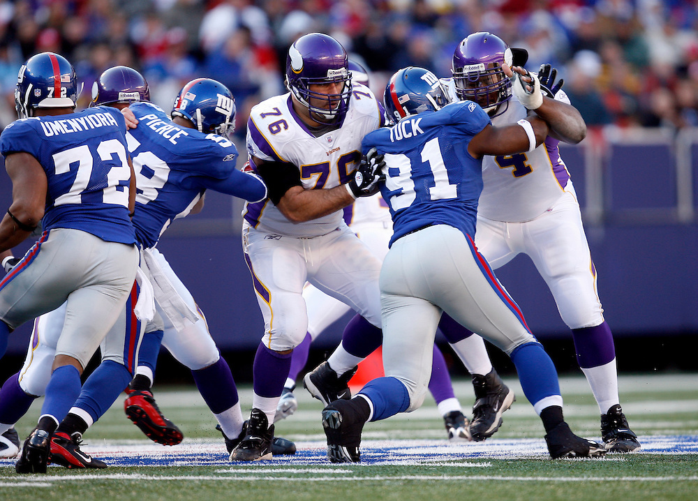 EAST RUTHERFORD, NJ - NOVEMBER 25: Steve Hutchinson #76 of the Minnesota Vikings blocks Justin Tuck #91of the New York Giants during their game at Giants Stadium on November 25, 2007 in East Rutherford, New Jersey. The Vikings defeated the Giants 41 to 17