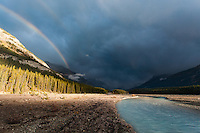 With a heavy thunderstorm approach at the boarder of Banff and Jasper National Parks, a beam of light lit up the valley ahead of the heavy rainfall.
