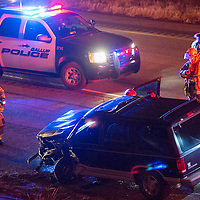 110113       Cable Hoover<br /> <br /> Gallup police and fire fighters inspect the scene of a crash on east bound Interstate 40 Friday.