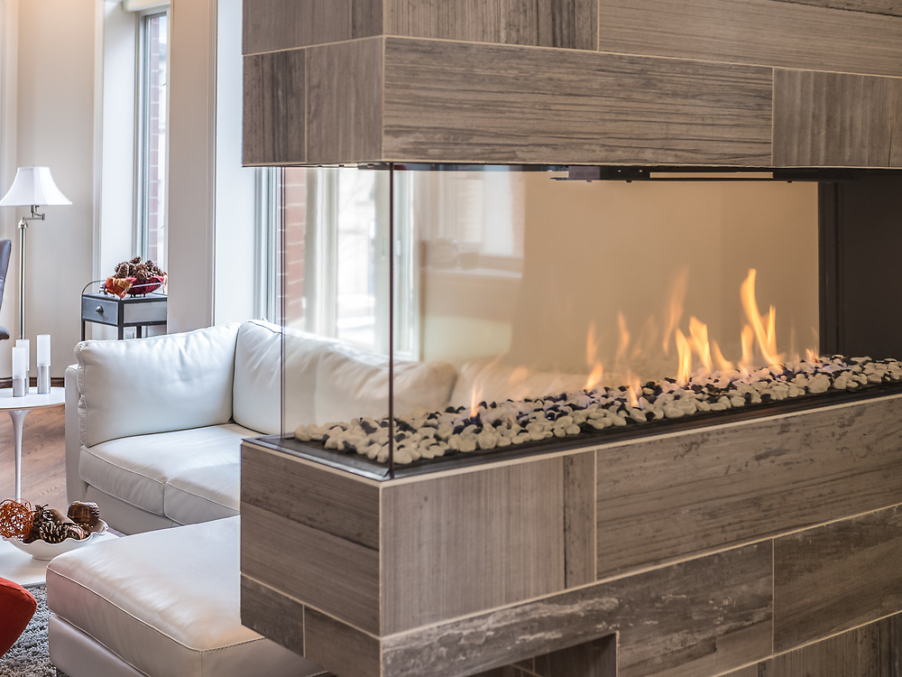 Contemporary Fireplace Separates Kitchen and Living Area