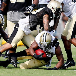 Aug 3, 2013; Metairie, LA, USA; New Orleans Saints running back Mark Ingram (22) is tackled by strong safety Kenny Vaccaro (32) during a scrimmage at the team training facility. Mandatory Credit: Derick E. Hingle-USA TODAY Sports