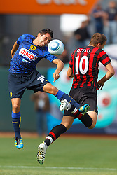 July 16, 2011; San Francisco, CA, USA;  Club America defender George Corral (34) wins a header from Manchester City forward Edin Dzeko (10) during the first half at AT&T Park.