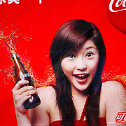 A Coca-Cola poster on the wall of a building in Yang Shao China.