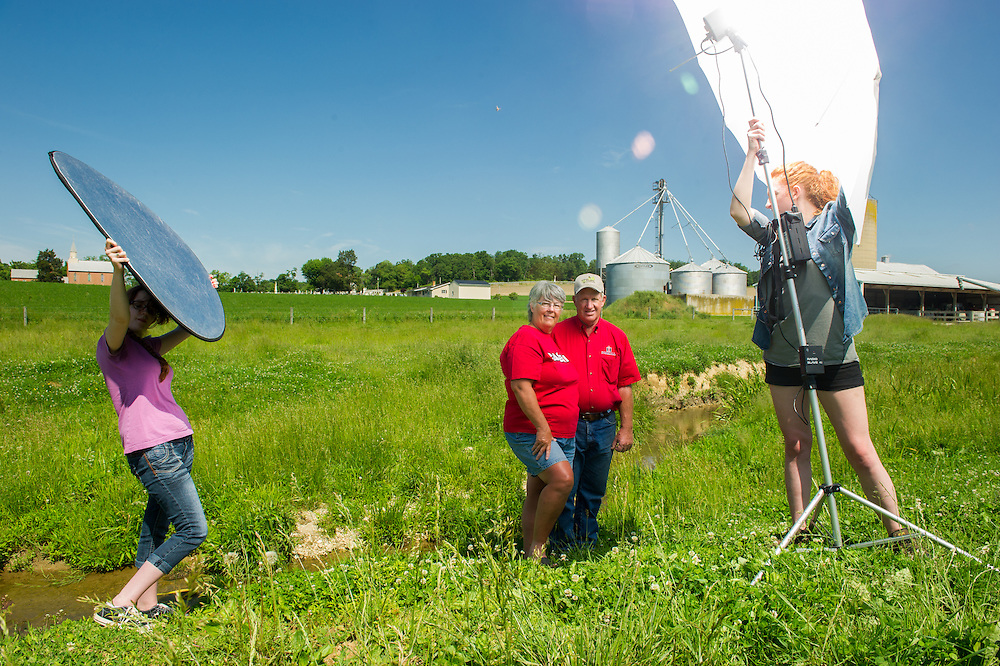 Photographers setting up equipment outside to photograph soy bean farmers in Mt. Airy, Maryland, USA