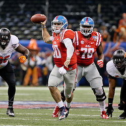Jan 1, 2016; New Orleans, LA, USA; Mississippi Rebels quarterback Chad Kelly (10) looks to throw against the Oklahoma State Cowboys during the second quarter in the 2016 Sugar Bowl at the Mercedes-Benz Superdome. Mandatory Credit: Derick E. Hingle-USA TODAY Sports