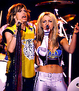 "Pop music star Britney Spears (R) and Steven Tyler (L) from the band ""Aerosmith"" perform during the halftime show at Super Bowl XXXV in Tampa, Florida. January 28, 2001."