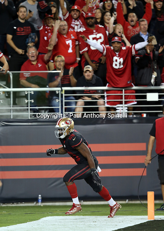 San Francisco 49ers running back Carlos Hyde (28) celebrates as the crowd cheers wildly after Hyde runs for a 17 yard fourth quarter touchdown and a 17-3 Niners lead during the 2015 NFL week 1 regular season football game against the Minnesota Vikings on Monday, Sept. 14, 2015 in Santa Clara, Calif. The 49ers won the game 20-3. (©Paul Anthony Spinelli)