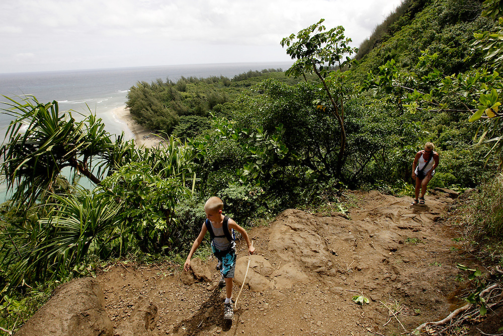 KAUAI, HI, July 12, 2007: Hikers explore the Kalalau Trail, one of Hawaii's most famous hikes on the North Shore of Kauai in Hawaii. The trail runs 11 miles along the Na Pali coast and provides amazing views.