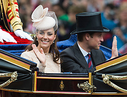 © London News Pictures. 05/06/2012. London, UK.  Catherine Duchess of Cambridge and Prince William travel by coach down The Mall  to Buckingham palace as part of the Diamond Jubilee Carriage procession on June 5, 2012.  Photo credit: Ben Cawthra/LNP