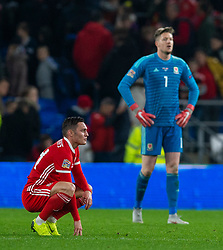 CARDIFF, WALES - Friday, November 16, 2018: Wales Connor Roberts and Wales goalkeeper Wayne Hennessey react after the UEFA Nations League Group Stage League B Group 4 match between Wales and Denmark at the Cardiff City Stadium. (Pic by David Rawcliffe/Propaganda)