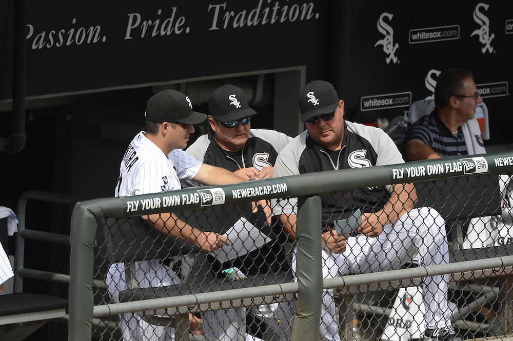 CHICAGO - SEPTEMBER 05:  Manager Robin Ventura #23 (left), pitching coach Don Cooper #21(center) and bench coach Mark Parent #8 (right) of the Chicago White Sox talk in the dugout during the game against the Minnesota Twins on September 05, 2012 at U.S. Cellular Field in Chicago, Illinois.  The White Sox defeated the Twins 6-2.  (Photo by Ron Vesely)  Subject:    Robin Ventura; Don Cooper; Mark Parent