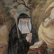Renee de Bourbon, detail added in the 19th century, replacing image of Louise de Bourbon de Levedon, 30th abbess of Fontevraud, 1611-37, from the Entombment, fresco, in the Salle Capitulaire or Chapter House at Fontevraud Abbey, Fontevraud-l'Abbaye, Loire Valley, Maine-et-Loire, France. The Chapter House was built in the 16th century and its walls were painted in 1563 with frescoes of scenes from Christ's Passion by the Anjou artist Thomas Pot. The abbey itself was founded in 1100 by Robert of Arbrissel, who created the Order of Fontevraud. It was a double monastery for monks and nuns, run by an abbess. The abbey is listed as a historic monument and a UNESCO World Heritage Site. Picture by Manuel Cohen