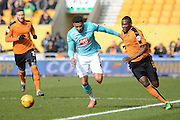 Wolverhampton Wanderers defender Jeremy Helan and Derby County defender Cyrus Christie chase the ball during the Sky Bet Championship match between Wolverhampton Wanderers and Derby County at Molineux, Wolverhampton, England on 27 February 2016. Photo by Alan Franklin.