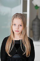 Portrait of sad young girl with long blond hair