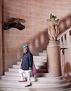 Maharaja Gaj Singh II at the footsteps of the marble and sandstone staircase in the Umaid Bhawan Palace. The carved eagles on the<br /> stone planter represent Chamunda Devi, the family deity of the Rathores. The trophy of the crouching leopard is a testimony to the tradition of shikar (hunting) that existed amongst the Rathores. He is dressed in jodhpurs, bandgala, and a lehariya safa, which is the traditional attire for the men of Jodhpur.
