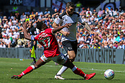 Barnsley defender Andy Yiadom challenges Derby County midfielder Bradley Johnson for the ball during the EFL Sky Bet Championship match between Derby County and Barnsley at the Pride Park, Derby, England on 6 May 2018. Picture by Aaron  Lupton.