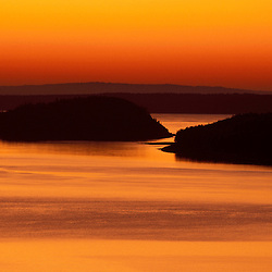 Acadia N.P., ME. Frenchman Bay at sunrise.  From Cadillac Mountain.  Porcupine Islands.