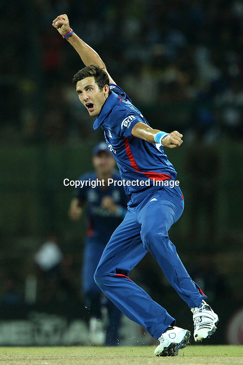 Steven Finn of England  celebrates the wicket of Tilakaratne Dilshan during the ICC World Twenty20 Super Eights match between England and Sri Lanka held at the  Pallekele Stadium in Kandy, Sri Lanka on the 1st October 2012<br /> <br /> Photo by Ron Gaunt/SPORTZPICS