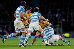 Australia Flanker Michael Hooper is tackled by Argentina Prop Marcos Ayerza - Mandatory byline: Rogan Thomson/JMP - 07966 386802 - 25/10/2015 - RUGBY UNION - Twickenham Stadium - London, England - Argentina v Australia - Rugby World Cup 2015 Semi Finals.