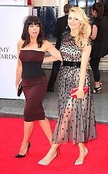 (L-R) Claudia Winkleman with Tess Daly arrives for the BAFTA TV Awards at the Theatre Royal, London, United Kingdom. Sunday, 18th May 2014. Picture by i-Images