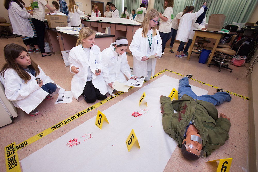 Students examine a mock crime scene during the Tech Savvy workshop CSI Athens at Ohio University May 17, 2014.  The full day event exposes girls from sixth through ninth grade to the field of science, technology, engineering and math.   Photo by Ohio University / Jonathan Adams
