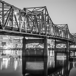 Peoria Illinois Murray Baker Bridge at night black and white photo. The Murray Baker Bridge spans the Illinois River connecting Peoria with East Peoria as Interstate I-74. Built in 1958, the bridge is named after Murray Baker who started a company that would later become Caterpillar.