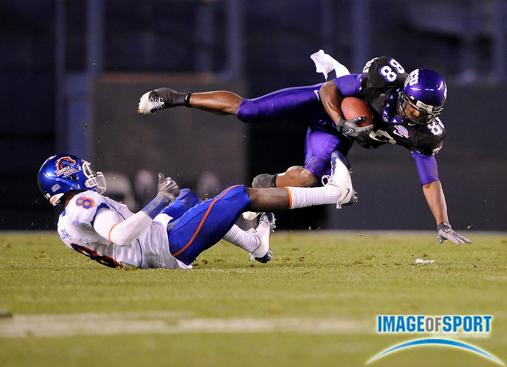Dec 23, 2008; San Diego, CA, USA; Texas Christian Horned Frogs receiver Jimmy Young (88) is upended by Boise State Broncos safety George Iloka (8) in the third quarter of the Horned Frogs' 17-16 victory in the Poinsettia Bowl at Qualcomm Stadium.