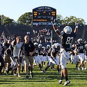 Yale celebrate their overtime win during the Yale V Army, Football match at Yale Bowl, New Haven. Yale won the match 49-43 in overtime in front of a crowd of 34,142. New Haven, Connecticut, USA. 27th September 2014. Photo Tim Clayton