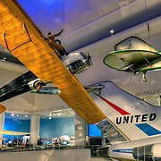 """The transportation gallery at the Museum of Science and Industry in Chicago features a United Airlines Boeing 727 and other smaller aircraft including a 1917 Curtiss JN-4D or """"Jenny"""" plane. Photo by Jennifer Rondinelli Reilly. All Rights Reserved. No use without permission."""